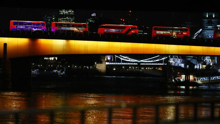 Idle buses are seen from the west side of London Bridge after an incident in the area in London,