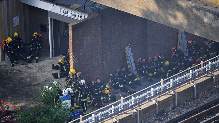 Fire fighters take a rest near the building