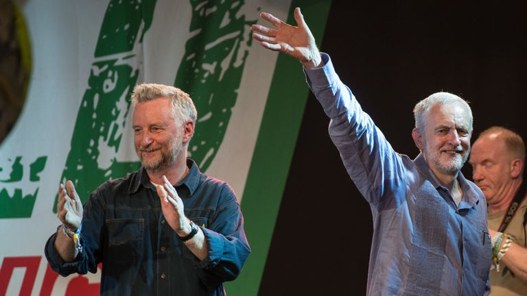 Labour Party leader Jeremy Corbyn on stage with Billy Bragg
