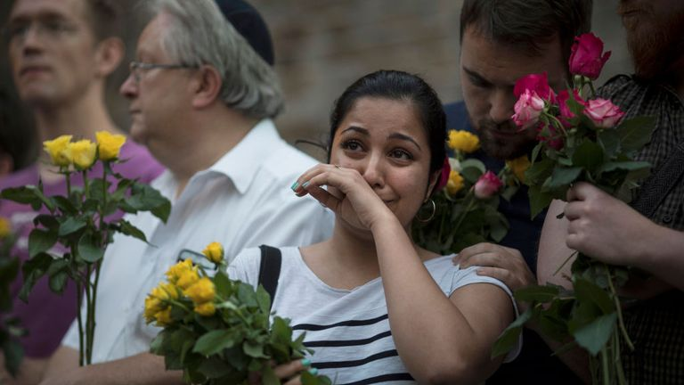 A woman cries during a vigil near the Finsbury Park Mosque