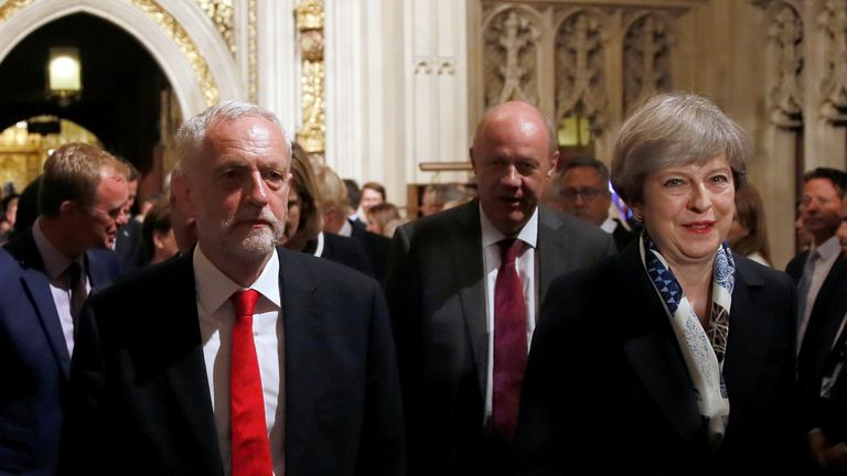 Jeremy Corbyn and Theresa May walking through the Houses of Parliament