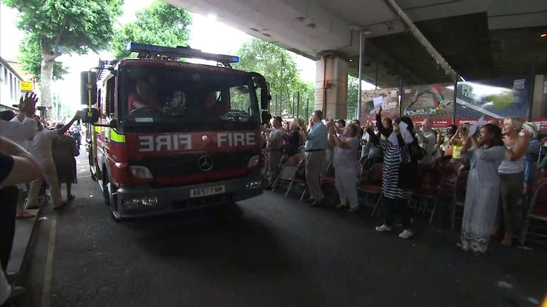 Firefighters leave Grenfell Tower to rounds of applause