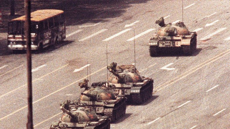 A man stands in front of a convoy of tanks in Tiananmen Square in 1989