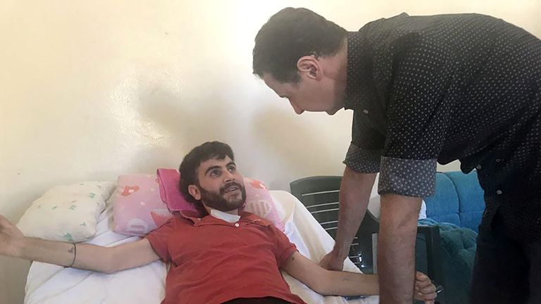 Assad visits an injured soldier in Hama province