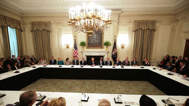 Donald Trump welcomes members of his American Technology Council in the State Dining Room of the White House
