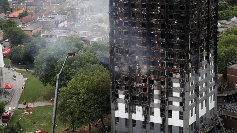 Firefighters work in the tower block