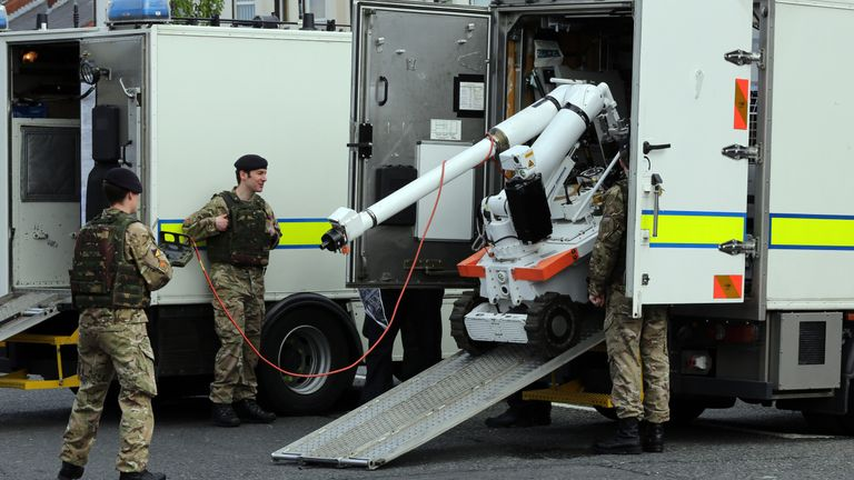 Bomb disposal experts at the scene of Connor's attack on police in May 2013