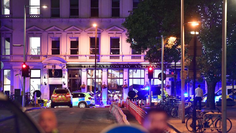 Police outside the Barrowboy and Banker pub in Borough High Street