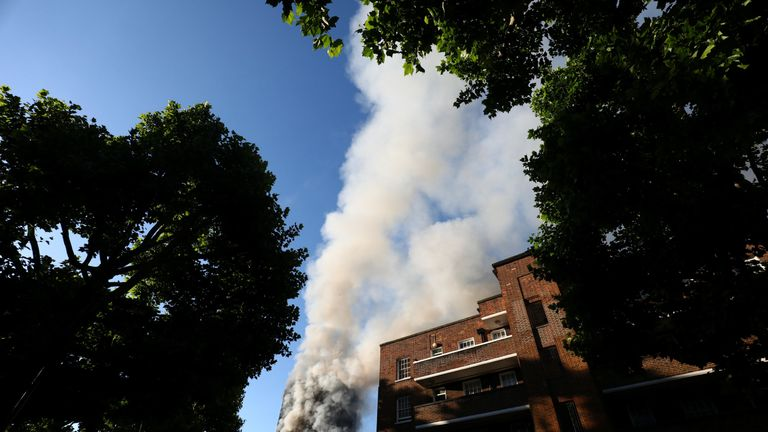Smoke billows from the tower block