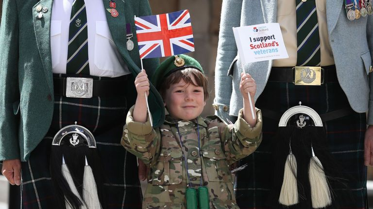 Six-year-old Luca Gordon with ex-service personnel in Edinburgh
