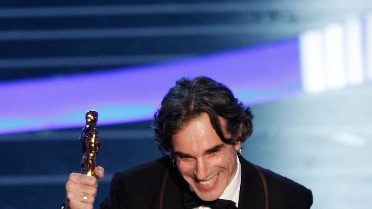 Day-Lewis picks up his Oscar for his role in There Will Be Blood in 2008