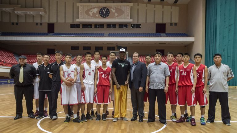 Rodman poses with North Korean basketball players at the Pyongyang Indoor Stadium