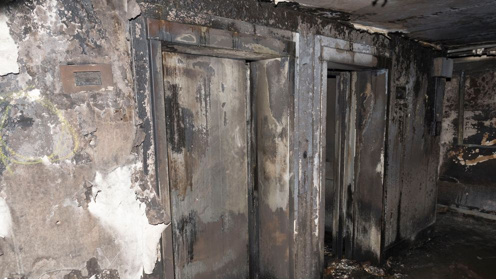 A set of fire-ravaged lifts can be seen in this image released by police