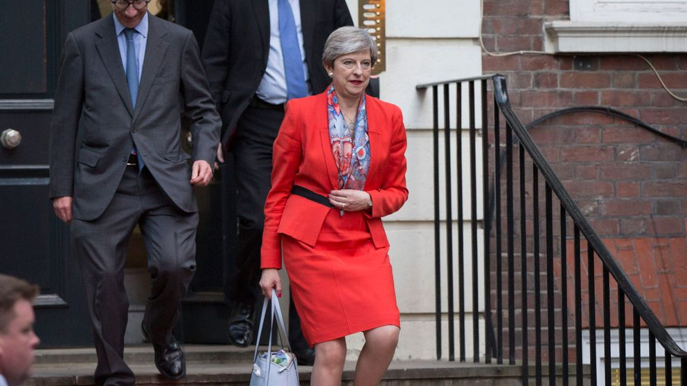 Prime Minister Theresa May leaves Conservative Party HQ in Westminster