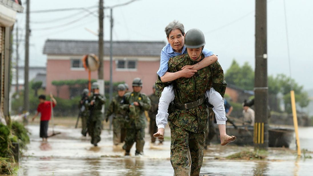Japanese soldiers help local residents evacuate from flooded Fukuoka prefecture