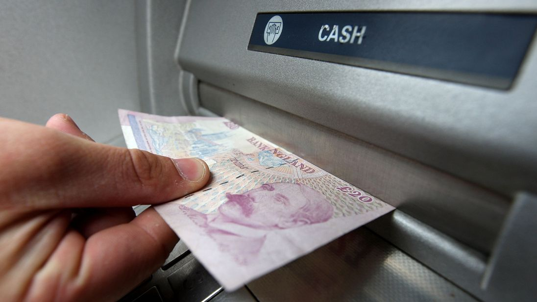 United Kingdom banks secure cuts in cash machine network costs