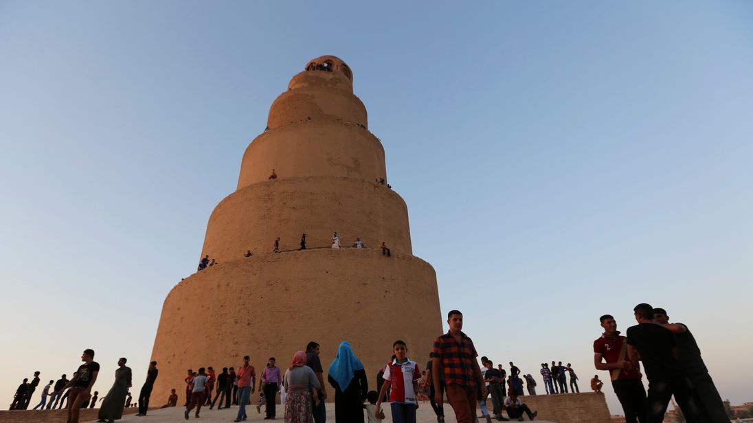 People visit the Spiral Minaret of the Great Mosque as they celebrate Eid al-Fitr in Samarra