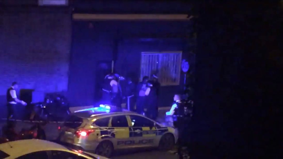 Police help one of the alleged victims of the acid attacks in Queensbridge Road, Hackney