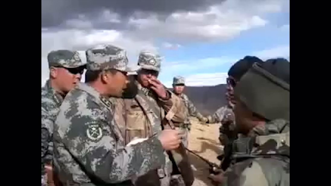 Chinese and Indian troops argue at the disputed border