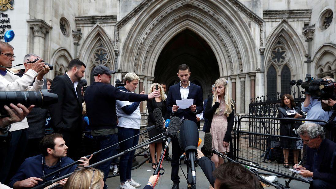 International media surround the parents of Charlie Gard