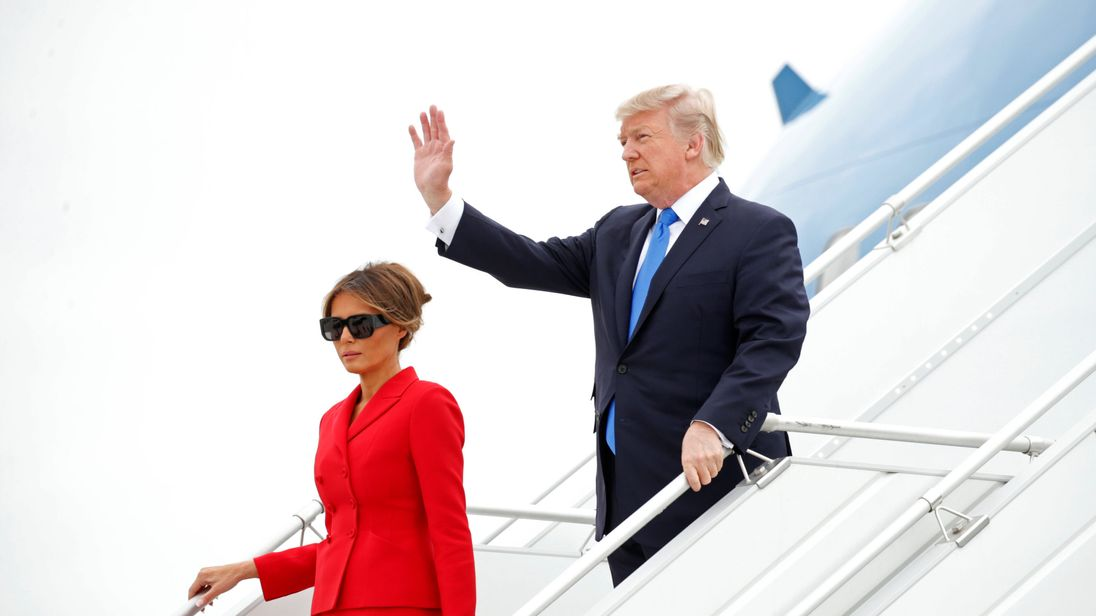 U.S. President Donald Trump and First Lady Melania Trump arrive aboard Air Force One at Orly airport near Paris