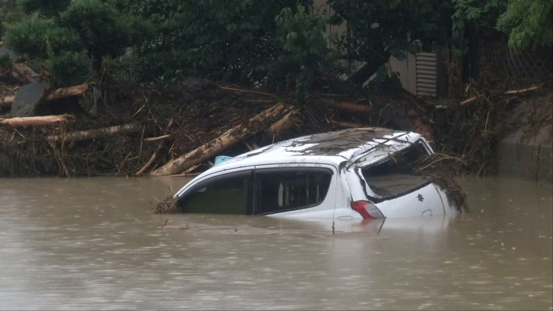 A partially submerged vehicle in Japan following heavy flooding