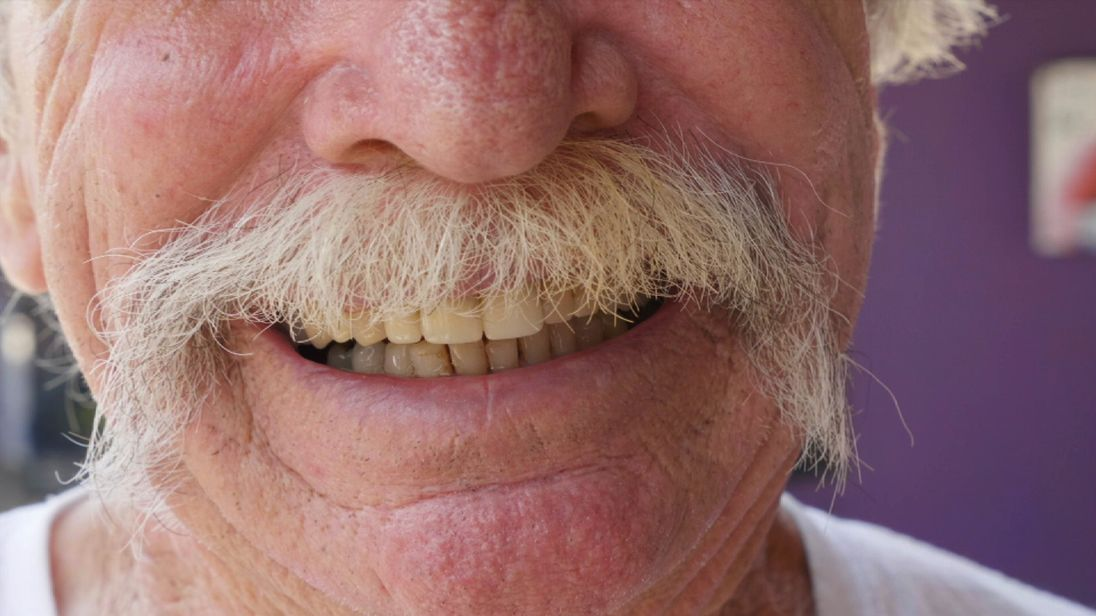 An American smiles during a visit to Molar City