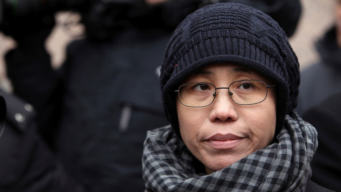 Liu Xia, the wife of Chinese dissident Liu Xiaobo, talks to the media in Beijing February 11, 2010