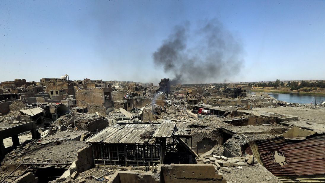 Smoke rises from clashes in the Old City of Mosul