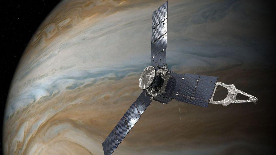 An artist's impression of Juno orbiting Jupiter. Pic NASA/JPL-Caltech