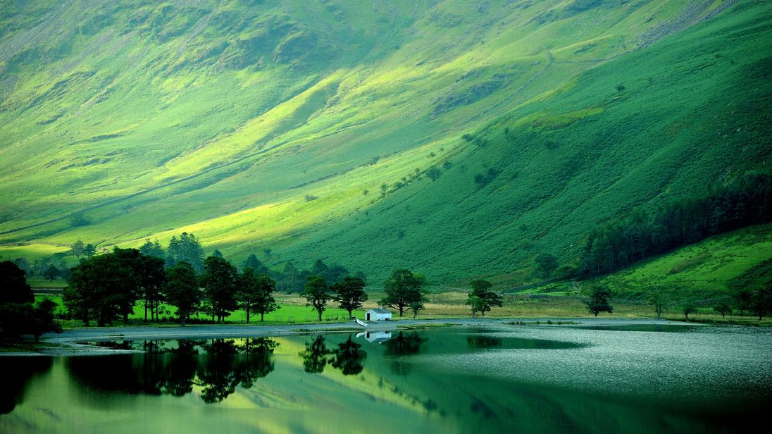 File photo dated 05/09/13 of early autumn reflections on Buttermere in the Lake District as England's largest national park is to be nominated for World Heritage status.