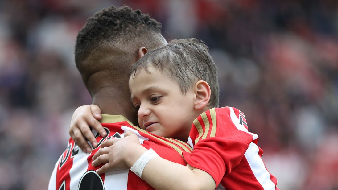 Jermain Defoe of Sunderland and Bradley Lowery