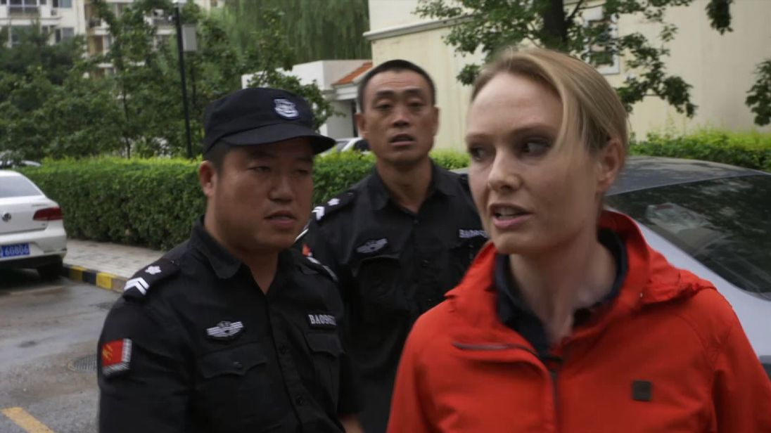 Katie Stallard is shoved away from Liu Xia's apartment in Beijing