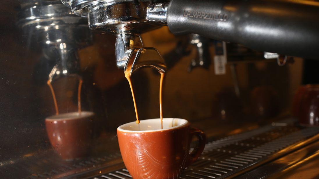An espresso machine in action