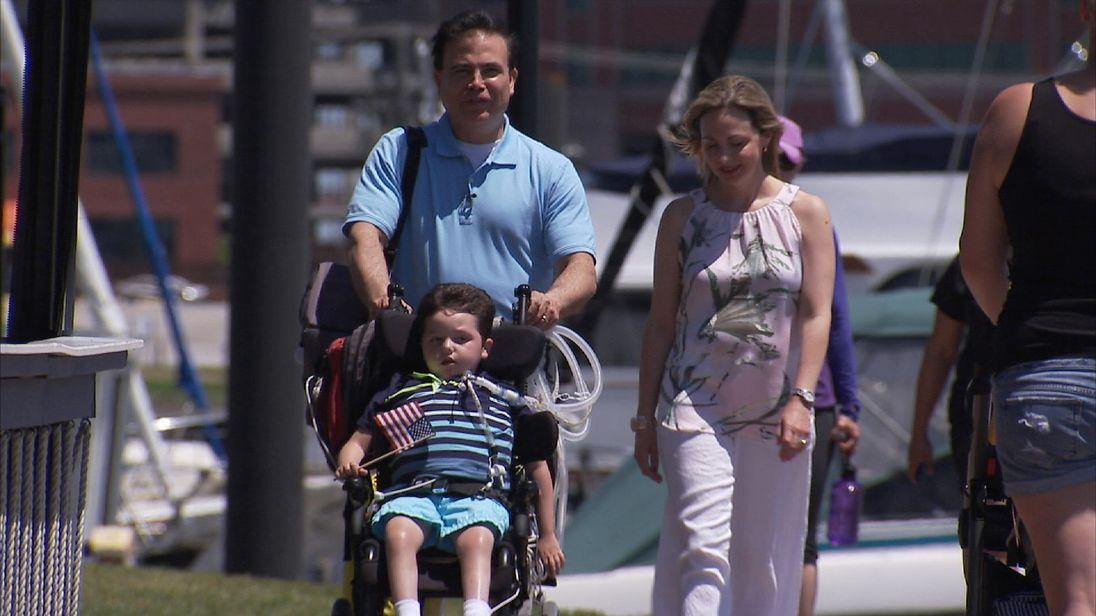 Art Estopinan, wife Olga and son Arturo Jr, who has a similar condition to that of Charlie Gard