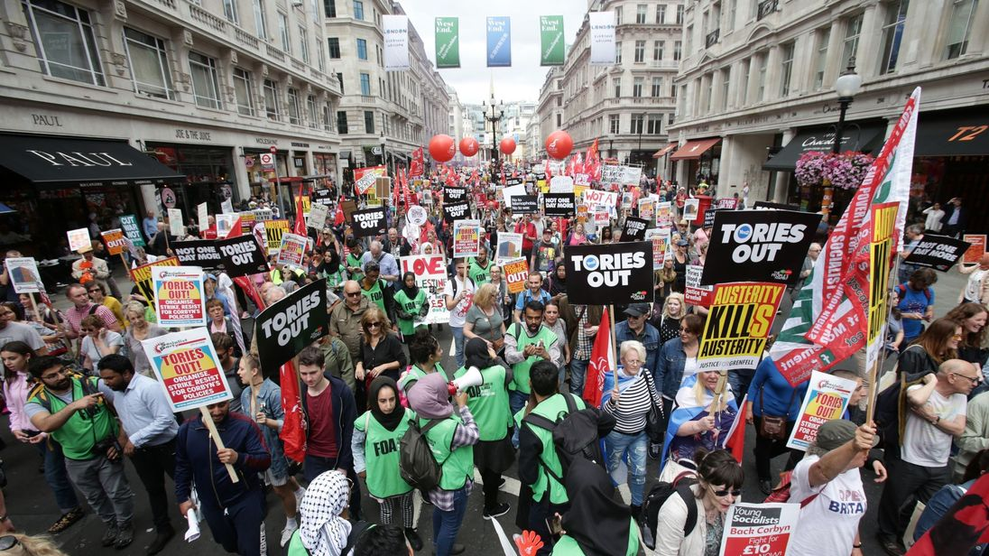 Anti-austerity campaigners march down Regent Street