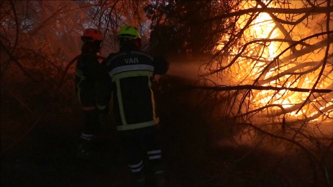 Firefighters tackle a blaze around St Tropez in the South of France