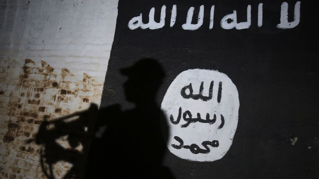 Mural bearing the logo of the Islamic State