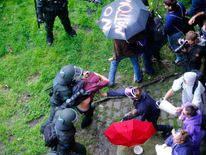 Anti-G20 protesters are detained as they try to breach the security zone and disrupt the G20 summit in Hamburg
