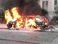 A car is seen on fire during anti-G20 protests in Hamburg, Germany. Pic: Youtube/Fasttorwa