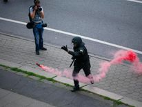 Police remove flares from the street