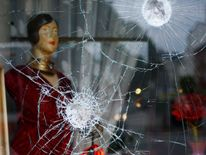 Smashed windows of a shop following demonstrations