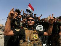 Iraqi Counter Terrorism Service celebrate in the Old City of Mosul