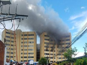 The Ministry of Finance building on fire in El Salvador. Pic: @ PROCIVILSV
