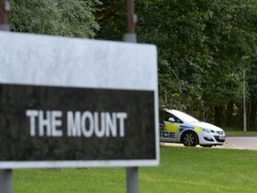 Police vehicles parked near The Mount Prison