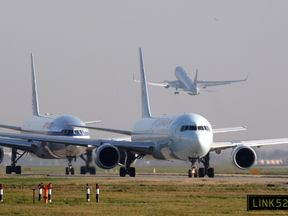 Planes queue to take off on the Southern runway at Heathrow Airport