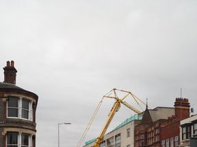 The crane rests against the Primark store after collapsing