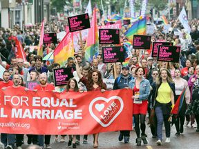 Gay rights campaigners march through Belfast to protest against the ban on same-sex marriage