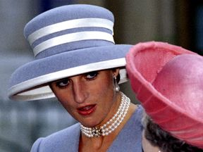 Diana chats to the Queen at St Margaret's Church in Westminster in October 1993