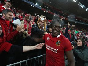 Maro Itoje of the Lions celebrates with friends and family after their victory during the match between the New Zealand All Blacks and the British & Irish Lions at Westpac Stadium on July 1, 2017 in Wellington, New Zealand